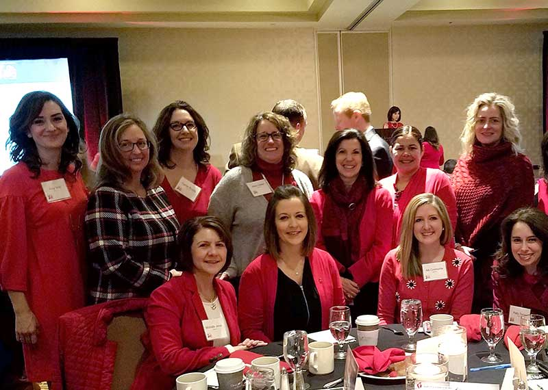 A group of Ingersoll Rand women gather around a table at the American Heart Association's annual Go Red for Women breakfast in Charlotte, North Carolina