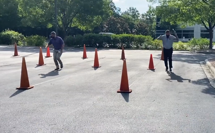 Trane Technologies CEO Mike Lamach and CFO Chris Kuehn participate in an egg race in a parking lot