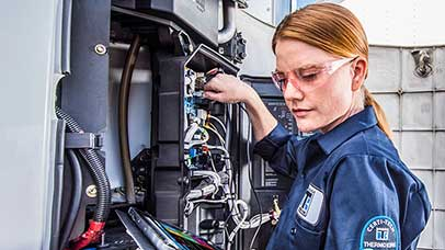 female maintenance technician working on a Thermo King unit